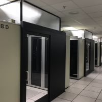 aisle containment doors in row in data center - rendering