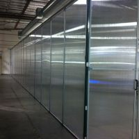 Aisle containment panel wall with double doors