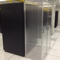 Aisle containment panel in data center with doors