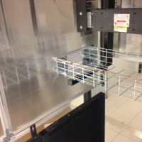 fixed vertical panels with wire rack on containment system