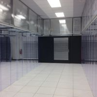 view in between 2 cold aisle containment systems in data center