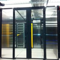 hinged containment doors installed on cold aisle in data center