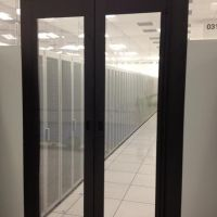 hinged containment doors in cold aisle of data center