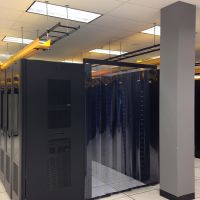 overlapping strip curtains enclosing hot aisle in data center