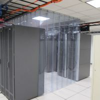 overlapping strip curtains containing a single cold aisle in a data center