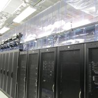 overlapping strip curtains containing cold aisle in a data center
