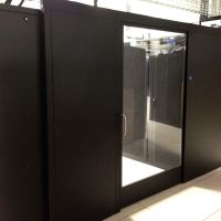 sliding containtment doors enclosing cold aisle in data center