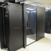 sliding containment doors separating aisle from data center